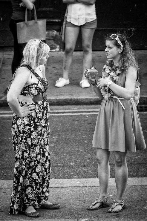 Two girls talking in the street just before the Brazilica Carnival